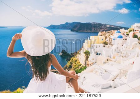 poster of Tourist woman at view of Santorini cruise travel. Beautiful white village of Oia with Caldera and me