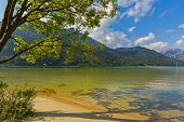 Crystal clear lake water of Achensee lake in blue green shade of fresh Turquoise water, northern par poster