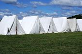 stock photo of revolutionary war  - Revolutionary War reenactment campsite with a row of tents.   ** Note: Slight graininess, best at smaller sizes - JPG