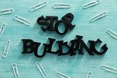 Text Stop bullying on color background poster