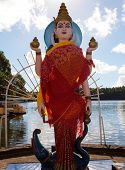 stock photo of saraswati  - Hindu Goddess Saraswati by sacred lake in Mauritius - JPG