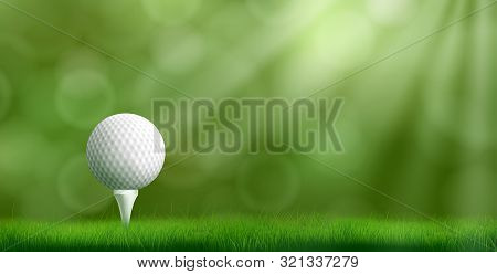 poster of Golf Ball Resting On Tee Pushed Into Ground, Cowered Thick Lawn Grass, Blurred With Bokeh Sunbeams O