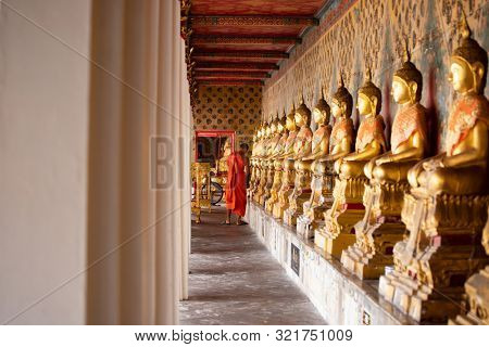 poster of Row of Golden Buddha in Thailand. Golden Buddha statues at Temple of the Emerald Buddha, Wat Phra Ka