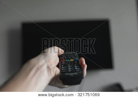 poster of The Man With The Remote Control In Hand Want Switch On The Tv And Presses The Button On The Remote C
