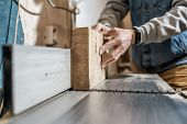 Man Making Wooden Parts For Furniture On Thickness Planer Machine. poster