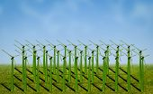 stock photo of electricity  - wind turbines covered with grass in a field - JPG