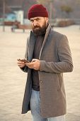 Menswear And Male Fashion Concept. Man Bearded Hipster Stylish Fashionable Coat And Hat. Stylish Mod poster