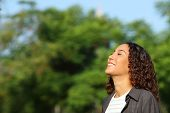 Happy Mixed Race Woman Breathing Deeply Fresh Air In A Park Or Forest A Sunny Day poster