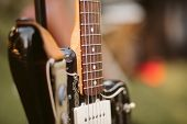 Close Up Of Electric Guitar. Detail Of The Strings.  Electric Guitar On A Stand Before A Concert. Gu poster