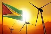 Guyana Wind Energy, Alternative Energy Environment Concept With Turbines And Flag On Sunset - Altern poster