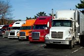 picture of 18-wheeler  - Truck trailers on rest area along american Interstate 95 - JPG