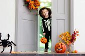 Kids Trick Or Treat. Halloween. Child At Door. poster