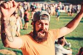 Man Bearded Hipster In Front Of Crowd. Open Air Concert. Fan Zone. Music Festival. Entertainment Con poster
