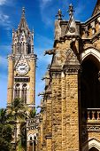 stock photo of british bombay  - University Tower on the background of blue skies - JPG