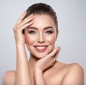 Beauty face of the young beautiful smiling woman  with a fresh healthy skin. Closeup portrait of an  poster