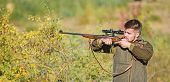 Bearded Serious Hunter Spend Leisure Hunting. Hunter Hold Rifle. Hunting Is Brutal Masculine Hobby.  poster