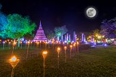 Sukhothai Co Lamplighter Loy Kratong Festival At The Sukhothai Historical Park Covers The Ruins Of S poster