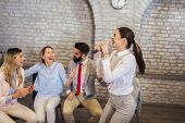 Business People Making Team Training Exercise During Team Building Seminar Singing Karaoke. Indoor T poster