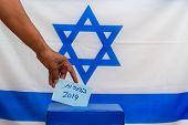 Election In Israel - Voting At The Ballot Box. The Hand Of Man Putting Vote In The Ballot Box. Israe poster