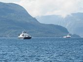Two Ferries Carrying Cars Sail Through The Fjord In Norway. poster