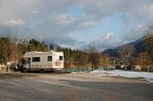 stock photo of campervan  - A motorhome parked in an empty mountain car park - JPG