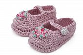stock photo of mary jane  - Pink crochet baby booties with flowers isolated on white Hand - JPG