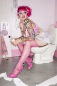 image of panty-hose  - Woman on toilet seat holding alcohol bottle - JPG