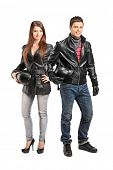 Full length portrait of two young motorcyclers in a leather jacket posing isolated on white backgrou