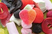 a pile of candies, one of them heart-shaped in the center