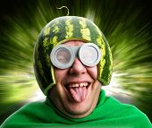 stock photo of maggot  - Funny man with watermelon helmet and googles looks like a parasitic caterpillar - JPG