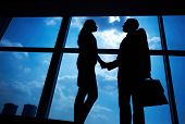 stock photo of striking  - Photo of successful businessman and businesswoman handshaking after striking deal - JPG