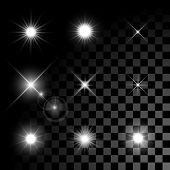 pic of illuminated  - Set of Vector glowing light effect stars bursts with sparkles on transparent background - JPG