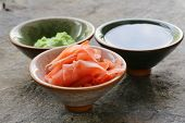 traditional Japanese condiments - wasabi, ginger and soy sauce