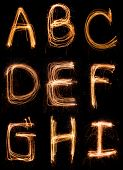 picture of hand alphabet  - A sparkler firework light alphabet A to I - JPG
