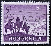 stamp celebrates Christmas showing the Magi carried by camels going to worship the Christ. Australia