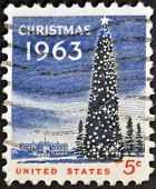 A stamp printed in USA shows the White House and the National Christmas Tree in Washington DC.