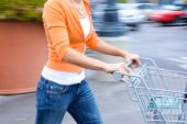 stock photo of grocery cart  - Supermarket Shopper in the supermarket with motion blur and cart - JPG