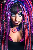 picture of dreadlocks  - Portrait of a stylish young woman with multicolored dreadlocks and with stylish make - JPG