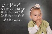 stock photo of thinkers pose  - Little baby thinking about mathematic problem on chalkboard - JPG