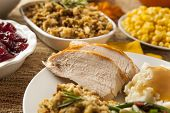 stock photo of breast  - Homemade Sliced Turkey Breast for Thanksgiving Dinner - JPG