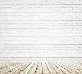 Background of age grungy white texture of paint stucco brick and stone wall with light wooden floor