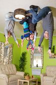 Family of five prays on the ceiling upside down at inverted house