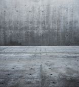 Large raw concrete space. flat concrete wall and floor.