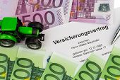 an insurance contract for new tractor. with euro money banknotes