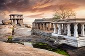 stock photo of vijayanagara  - Ancient ruins of Vijayanagara Empire at sunset sky in Hampi Karnataka India - JPG