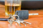 picture of underage  - image of keys and alcohol a drink driving concept image  - JPG