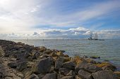 pic of dike  - Trawler fishing on a lake along a dike - JPG