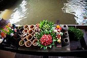 stock photo of chan  - Fresh ingredients in a boat at Taling Chan floating market - JPG