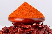 picture of chillies  - chilly powder with red chilly on white background - JPG