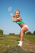 image of badminton player  - badminton player in action  - JPG